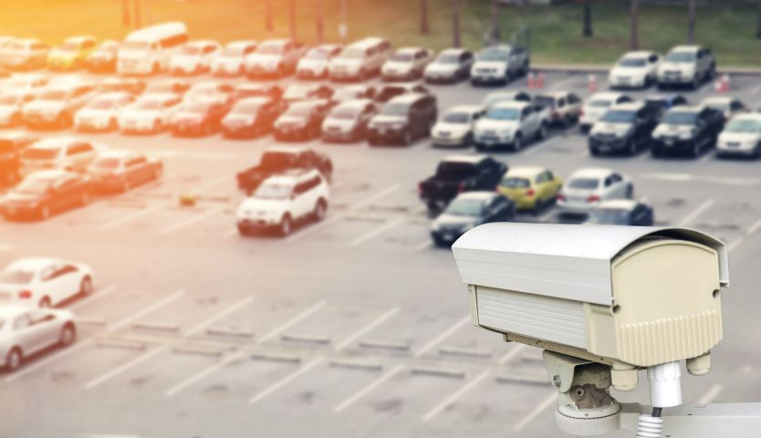 A security camera overlooking a parking lot