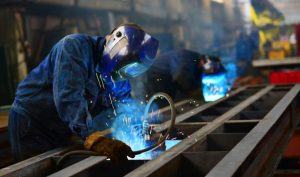 Manufacturing plant workers welding