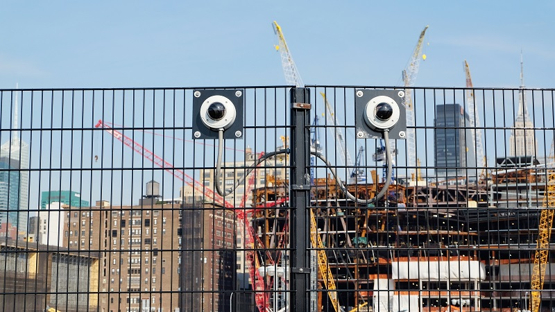 Surveillance cameras at the entrance to a construction site