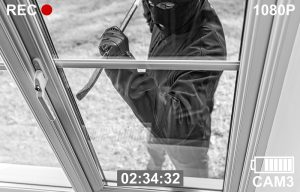 Burglar attempting to break in to a business caught on surveillance footage