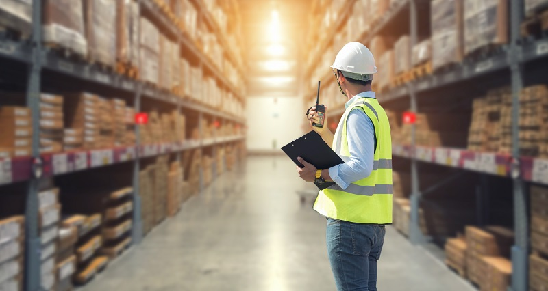Warehouse worker performing security check