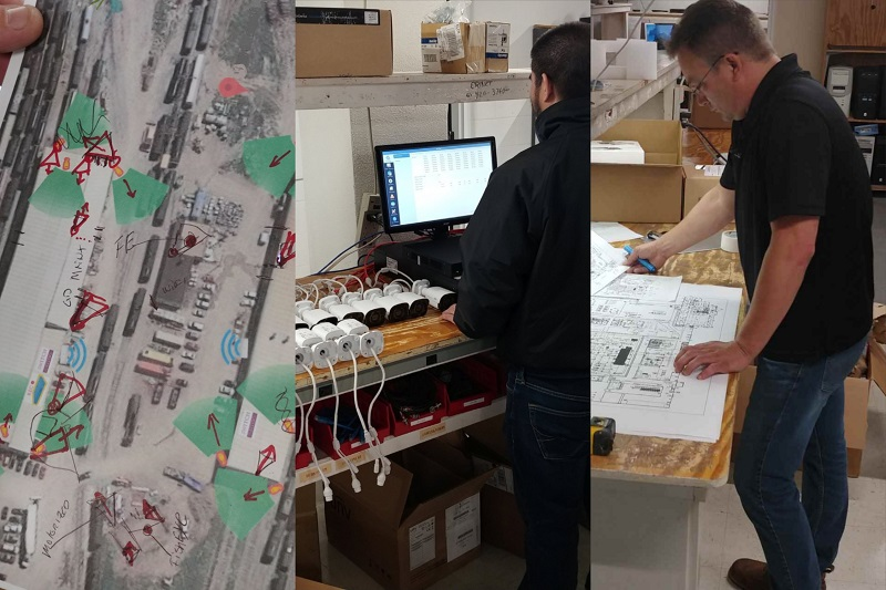 technicians analyzing schematics for an installation